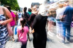 People walking in the city with zoom effect. Abstract picture with camera made zoom effect of people walking in the city with zoom effect Royalty Free Stock Images