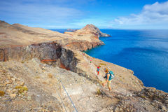 People walking on the cliffs at Ponta de Sao Lourenco stock image
