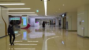 People walking at Coex Shopping Mall in Seoul, Korea. COEX Mall is one of the largest underground shopping centers in Asia stock footage