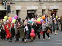 People walking with colorful baloons and flowers Stock Photo