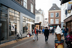 People walking on commercial street in historic centre of Utrech. Utrecht, Netherlands - August 4, 2016: People walking on commercial street in historic centre Stock Photos