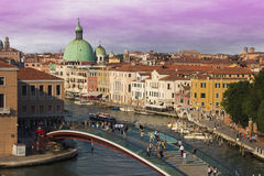 People walking on the Constitution Bridge over the Canal Grande of Venice Stock Photos