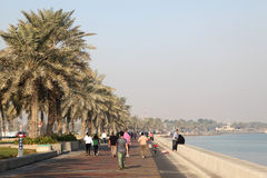 People walking on corniche, Doha Stock Photography