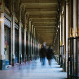 People. Walking in a corridor, motion blur, toned image Royalty Free Stock Images