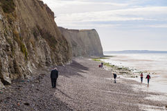 People walking on Cote d'Opale coast with white cliffs near Audresselles, France Stock Photos