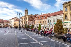 People walking in the Council Square, Brasov, Romania. People walking in the Council Square PiaÈ›a Sfatului. The most famous city area holds the markets stock image