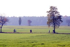 People walking through countryside. Royalty Free Stock Image