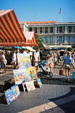 People walking by Cours Saleya antique market, Nice, France stock photos