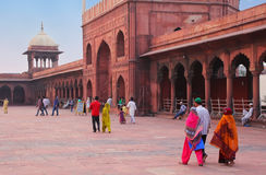 People walking in a courtyard of Jama Masjid, Delhi, India Stock Photography