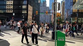 People walking and crossing the street stock video footage