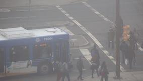 People walking through crosswalk stock video footage