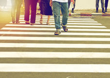 People walking on crosswalk Royalty Free Stock Photography