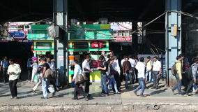 People walking through a crowded train station in Mumbai. stock video footage