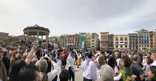 People walking and dancing at plaza del castillo in Pamplona, Navarra royalty free stock photo