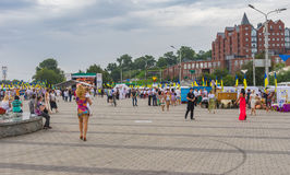 People walking on the Dnepr river embankment during Independence Day celebrations. Dnepr, Ukraine - August 24, 2016:People walking on the Dnepr river embankment royalty free stock photos