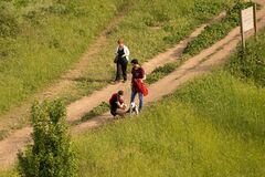 People walking with dog in a meadow during self-isolation in Rome, Italy