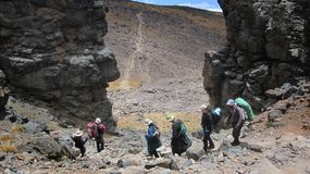 People walking down from Barranco Wall to the spend the night at the next camp, on the royalty free stock photo