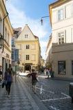 People walking down Na Perstine street in Old Town, Prague Stock Image