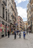 People walking down a shopping street Stock Image