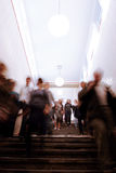 People walking down a staircase Stock Photo