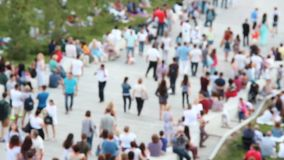 People walking down the stairs.Summer day, sunny day. Blurry crowd background stock video footage