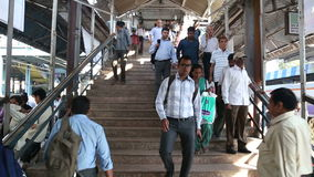 People walking down the stairs towards the train station in Mumbai. MUMBAI, INDIA - 9 JANUARY 2015: People walking down the stairs towards the train station in stock footage