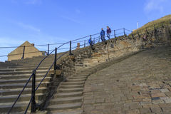 People walking down the 199 steps whitby Royalty Free Stock Photo