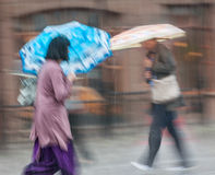 People walking down the street in rainy day Stock Images