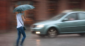 People walking down the street in rainy day. Stock Images