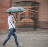 People walking down the street in rainy day Stock Image
