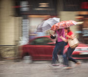 People walking down the street in rainy day Stock Photo