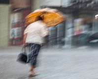 People walking down the street in rainy day Royalty Free Stock Photo