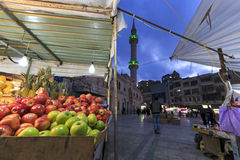 People walking in the downtown Amman market. Grand Husseini Mosque on foreground Royalty Free Stock Photography