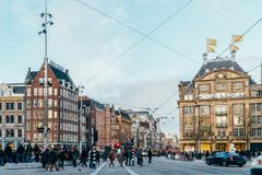 People Walking In Downtown Amsterdam Admiring Beautiful Architecture Of Dutch Houses Royalty Free Stock Photos