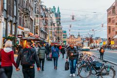 People Walking In Downtown Amsterdam Admiring Beautiful Architecture Of Dutch Houses Royalty Free Stock Photo