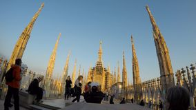 People walking on Duomo Cathedral roof terrace in Milan, Italy. The Gothic cathed stock video footage