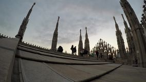 People walking on Duomo Cathedral roof terrace in Milan, Italy. The Gothic cathed stock video