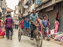 People walking at Durbar Square in Kathmandu. KATHMANDU - OCTOBER 05: People walking at Durbar Square in Kathmandu, Nepal, October 05, 2017 Stock Images