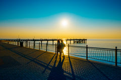 People walking on the embankment at Baltic Sea coast Stock Photography