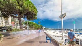 People walking at embankment near famous `La Croisette` Boulevard timelapse hyperlapse. French Riviera. People walking at embankment near famous La Croisette stock footage