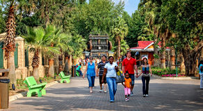 People are walking and enjoying their holiday in an amusement pa Royalty Free Stock Images