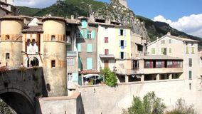 People walking in the entrance of the medieval city of Entrevaux, South of France stock video