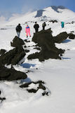 People walking on Etna Volcano covered by snow Royalty Free Stock Photography