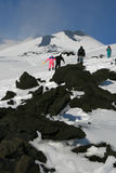 People walking on Etna Volcano covered by snow Stock Photos
