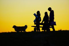 People walking evening of the hill with his dog royalty free stock image