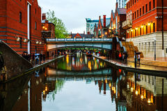 People walking at famous Birmingham canal in UK. Birmingham, UK. People walking during the rain in the evening at famous Birmingham canal in UK stock images