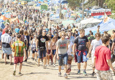 People walking among festival attractions. Stock Photography