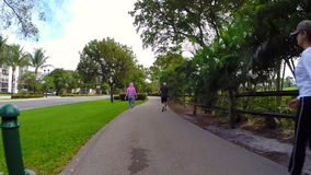 People walking on a fitness trail stock footage
