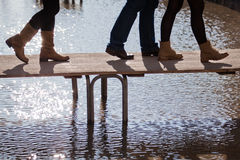 People walking at flood on a footbridge Stock Photography