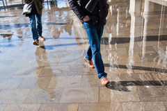People walking on the flooded pavement. Of the St. Mark's Square in Venice Royalty Free Stock Image